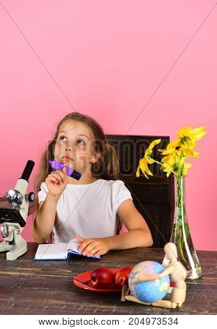 Girl With Dreamy Face Holds Purple Marker. Schoolgirl At Desk
