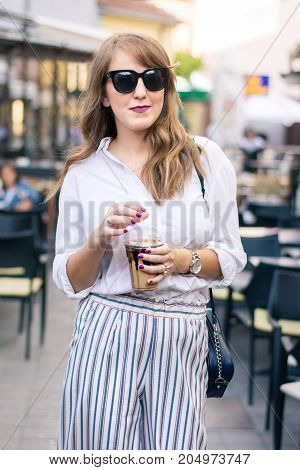 Young Woman With Coffee To Go On The Street