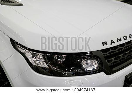 Sankt-Petersburg Russia July 21 2017: Front view headlight of a white Land Rover Range Rover Sport 2017. Car exterior details. Photo Taken at Royal Auto Show July 21