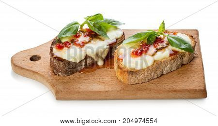 Bruschetta with mozzarella cheese tomato confiture and green basil leaf isolated on white background