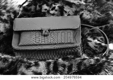 Red Stylish Female Leather Handbag On Fur Coat