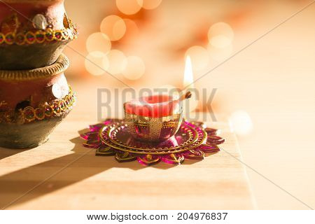 diwali lights placed nearby diyas in low light