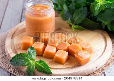 Fruit frozen cubes on a wooden board