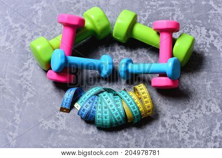 Dumbbells Made Of Pink, Green And Cyan Plastic
