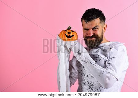 Guy With Beard Holds Smiling Jack O Lantern. Halloween Character
