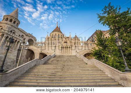 Budapest Hungary - The beautiful stairs of the Fisherman bastion with the Matthias Church in the morning with blue sky