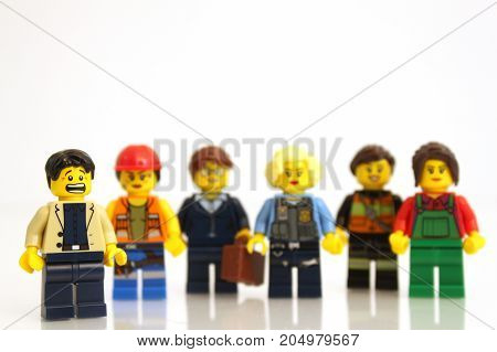 Colorado, USA - September 19, 2017: LEGO businesswomen representing a variety of jobs with scared man, studio shot isolated on white background.