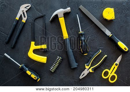 building, painting and repair tools for house constructor work place set on dark background top view pattern