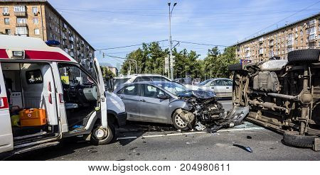 Moscow Russia - September 20 2017: Accident involving an overturned ambulance. The doctors of the ambulance were injured. The ambulance ran into a car and rolled over.