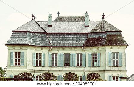 Beautiful Schloss Niederweiden in Austria. Architectural scene. Retro photo filter. Travel destination.