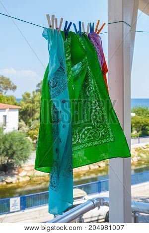 Four Colorful Bandanas Hang On Rope Outdoor