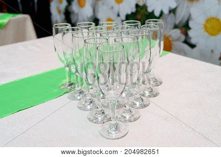Rows Of Empty Glasses For Champagne On The Table, Selective Focus, Free Space. Set Of Sparkling Glas