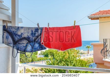 Shirt And Shorts Hang On A Rope In The Street