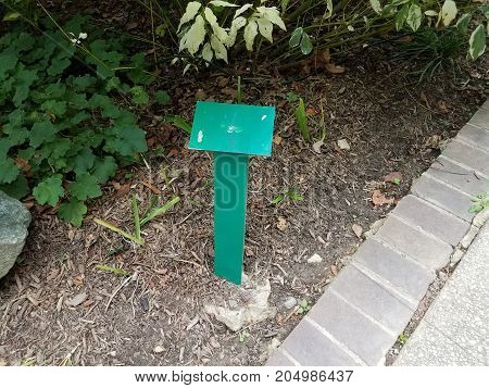 a green metal sign with nothing on it