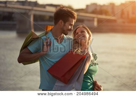 Image of young happy couple shopping together.