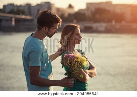 Image of young couple having conflict while standing outdoor.