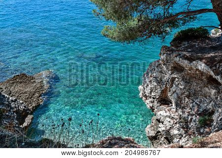Rocky beach in a small bay with a view from above the cliff