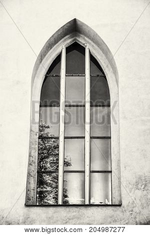Old window with reflections Spilberk castle Brno southern Moravia Czech republic. Architectural element. Black and white photo.