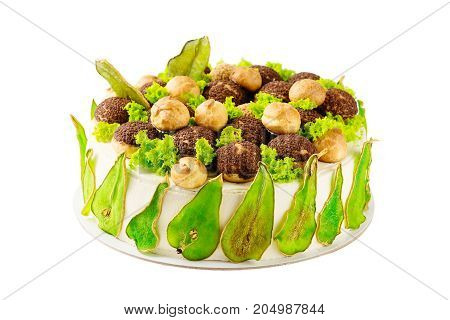 Homemade Cake Decorated With Green Colored Pears And Profiteroles Isolated On White