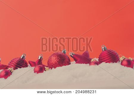Christmas scene with snow - row of balls with red background, retro toned