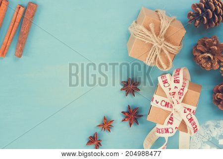 Blue rustic christmas - styled christmas composition flat lay style with gift boxes and cones, retro toned