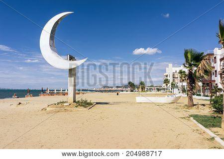ALBANIA GOLEM- September 21 2015: Beach resort Golem with one of the main symbols of Albania crescent on the pedestal