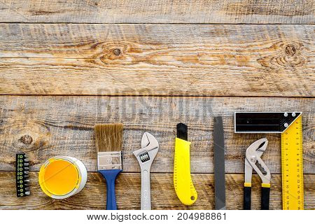 constructor desk with set of building implements on wooden desk background top view mock up