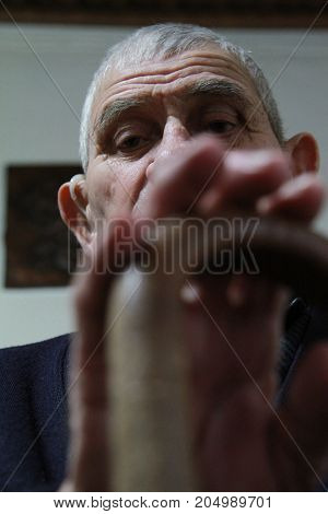 Close Up Portrait Of An Elderly Man Holding A Cane, Soft Focus.