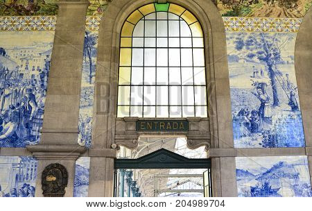 PORTO PORTUGAL - AUGUST 12 2017: Famous railway station Sao Bento with Azulejo panels with scenes of the History of Portugal