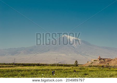 Khor Virap Monastery. Mount Ararat on background. Exploring Armenia. Tourism, travel concept. Mountain landscape. Religious landmark. Tourist attraction. Copy space for text. Ecotourism, agriculture