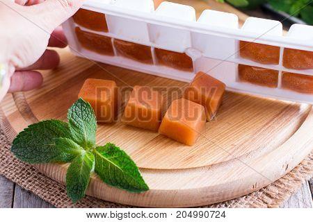 Fruit frozen cubes in an ice cube