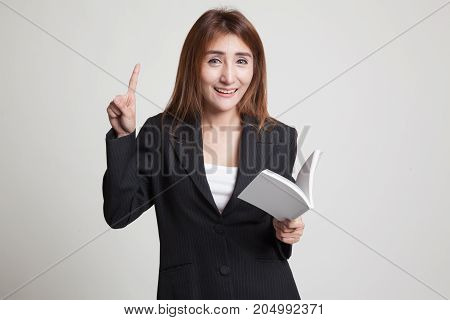 Young Asian Woman With A Book Have An Idea.