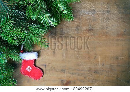 Christmas background with christmas stocking and christmas tree branches