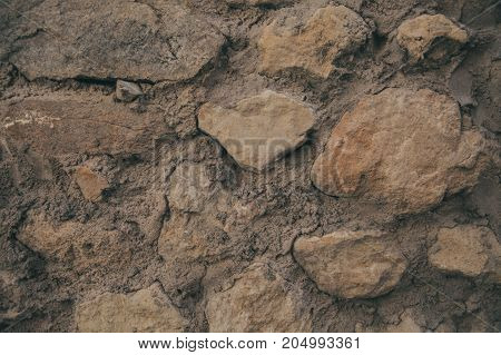 Old wall texture and background. Wall background for graphic design. Abstract texture and background for designers. Old rough wall texture and background. Handmade ancient wall. Old stone wall.
