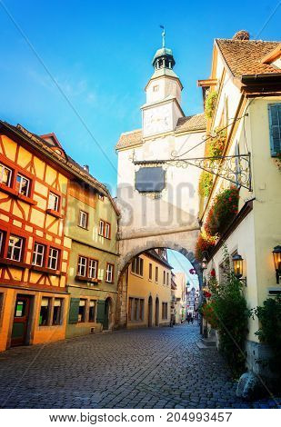 small street with half-timbered houses of Rothenburg ob der Tauber, Germany, retro toned