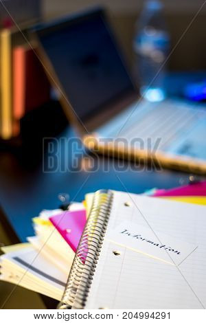 Information; Stack Of Documents And Laptop At Working Desk.
