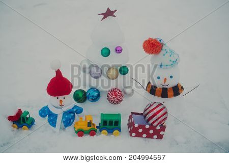 Snowmen With Smiley Faces In Clothing