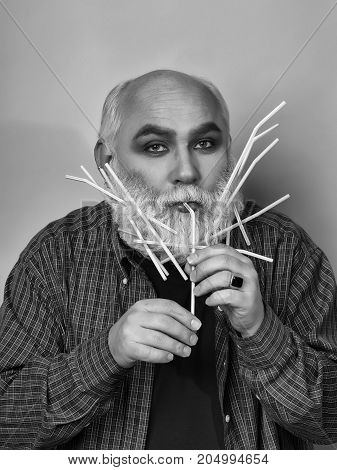 Old Man With Drinking Straws In Beard