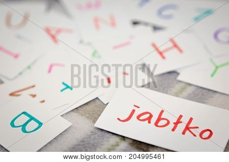 Polish; Learning The New Word With The Alphabet Cards; Writing Apple