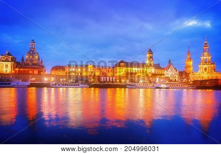 Embankment of Dresden and river Elbe at night, Germany, retro toned