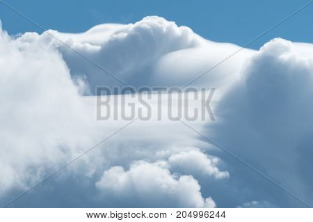 Dramatic white clouds on a windoy sunny day