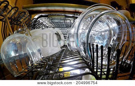 dishwasher. The glasswares in a basket . poster