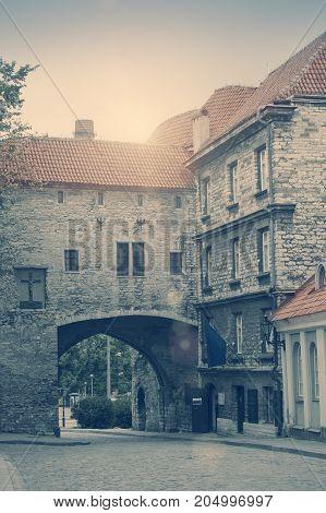 Old city in Tallinn Estonia. Big Sea gate. toning
