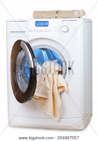 The washing machine with an open door and towels