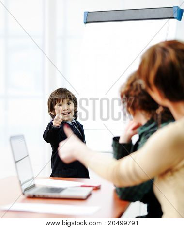 Genius kid on business presentation speaking to adults and giving them a lecture