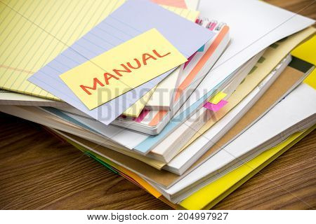 Manual; The Pile Of Business Documents On The Desk