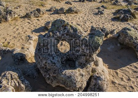 Pobiti stones - they represent stone columns with different height?(5 to 7 m), thickness (0.3 to 3 m) and different section. They look like they're in the sand and that's where their name comes from.