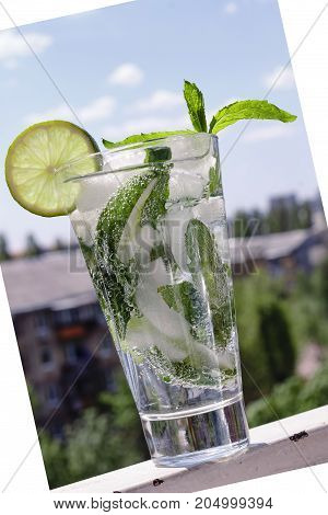 Mojito In A Glass On A Background Of A Modern Cit