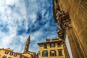 Badia Fiorentina steeple and Museo del Bargello in Florence Italy poster