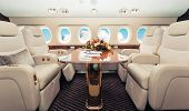 Luxury interior in bright colors of genuine leather in the business jet poster